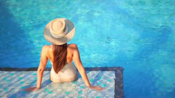 footage of beautiful young asian woman relax smile leisure around outdoor swimming pool nearly sea beach ocean for holiday vacation