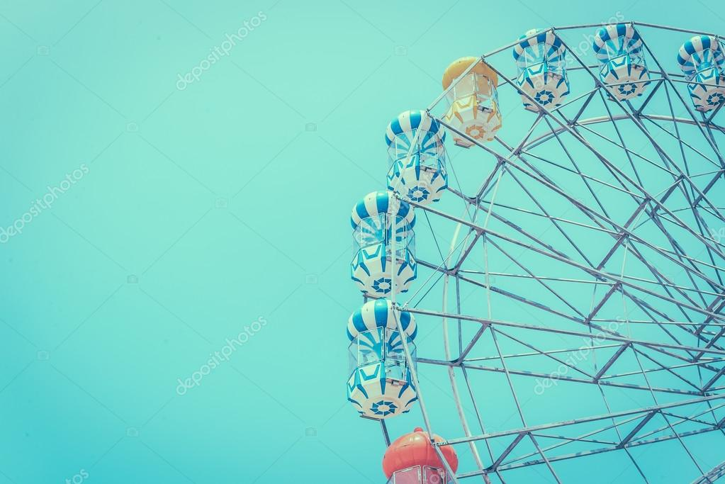Ferris wheel over blue sky
