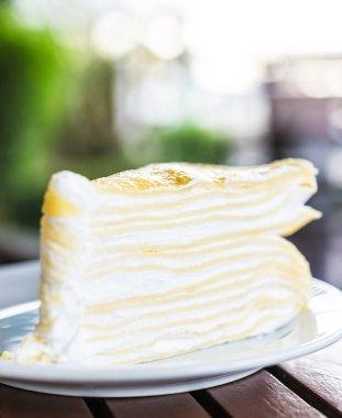 Dessert crepe cake in white plate