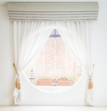 Curtain on window in room