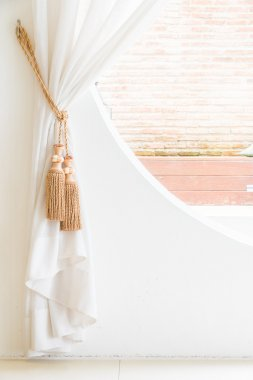 Curtain on window in room