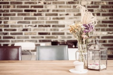 Dry flower in vase and candle decoration in coffee shop cafe, vintage filter effect stock vector