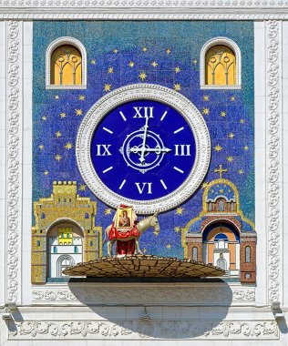 Clock with figure of donkey carrying icon in Yoshkar-Ola, Russia