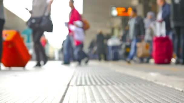 Blurred footage of people in airport
