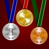 Photo Gold, silver and bronze medals with laurel wreaths