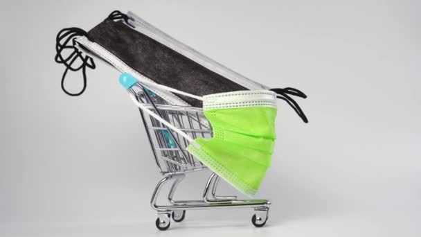 Shopping cart with medical protective masks on a white background. Close up. Medical supplies concept