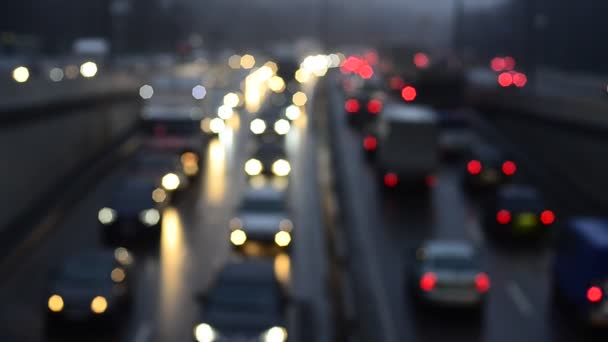defocused footage of moving traffic lights