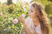 Fotografie Woman in a rose garden