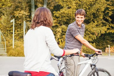 Girl and boy cycling together