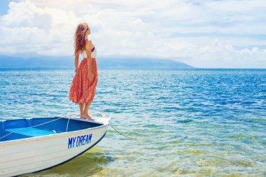 Woman sailing on a beautiful boat