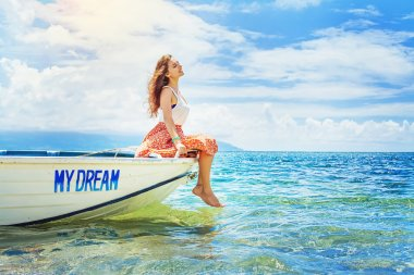 Woman sitting in a beautiful boat
