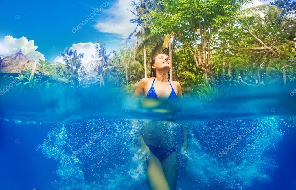Woman having fun in the pool