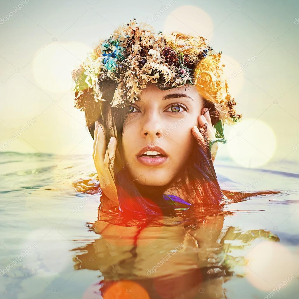 Woman in a wreath  in the water