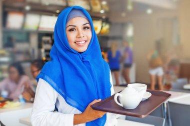 waitress holding a tray with tea