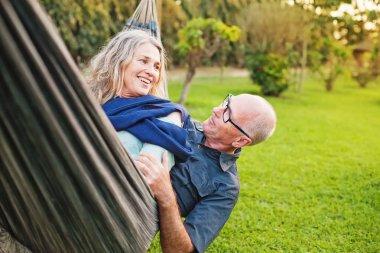 Senior european couple  lying  in hammock