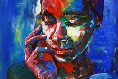 woman completely covered with thick paint