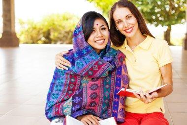 woman  teaching  poor asian woman