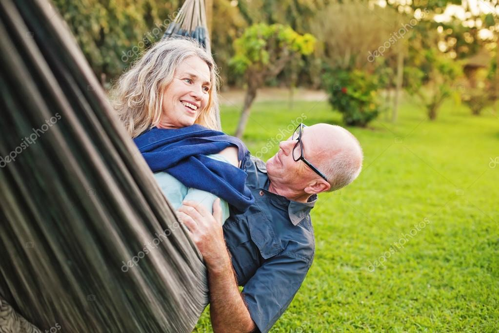 Senior european couple  lying  in hammock