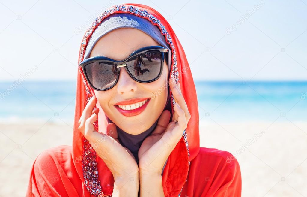 muslim caucasian  woman  on the beach