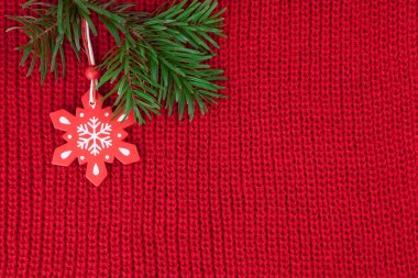 Christmas winter background of red wool knitted fabric with decoration