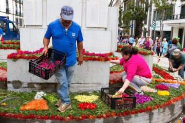 FUNCHAL, MADEIRA - APRIL 16, 2015: Flower carpets were laid along the median of the main shopping street in Funchal City, Madeira, Portugal.