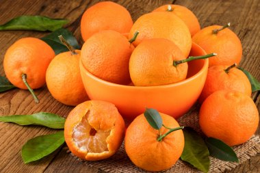 Mandarins Tangerines on Rustic Background