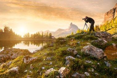 Photographer in beautiful lake Federa