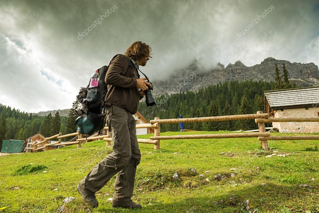 Man photographer hiking at shelter house