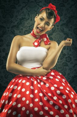 Woman smiles in polka dots clothes