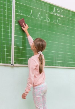 student cleaing the  board
