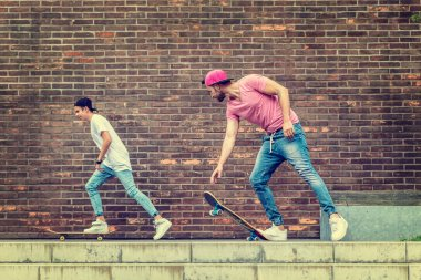 Manle Skateboarders by  brick wall stock vector