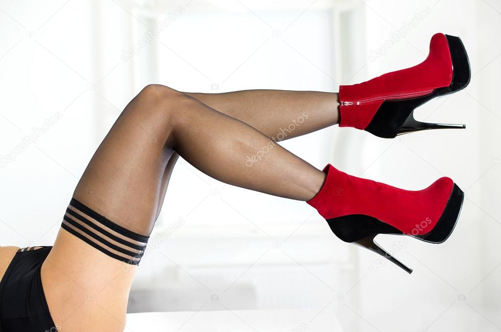 Something is. Sexy legs in stockings and heels