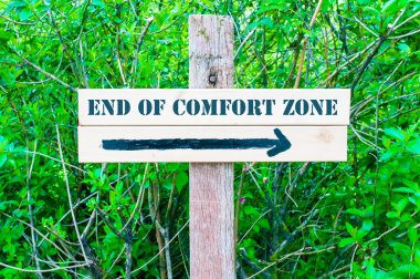 END OF COMFORT ZONE Directional sign