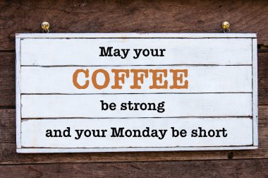 May Your Coffee be strong and your Monday be short message written on vintage wooden board. Motivational concept image stock vector