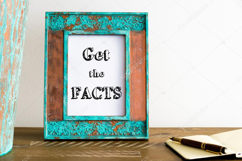 Vintage photo frame on wooden table with text GET THE FACTS — Stock ...