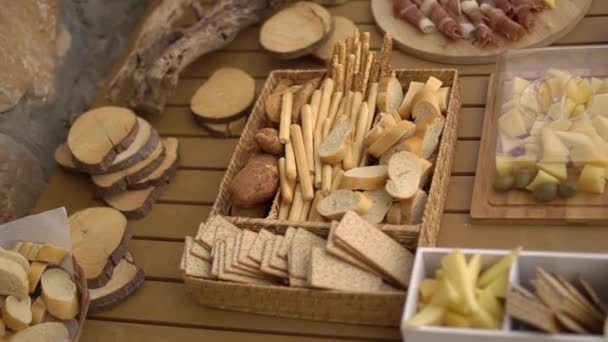 wedding buffet with fruit snacks on a wooden table close-up