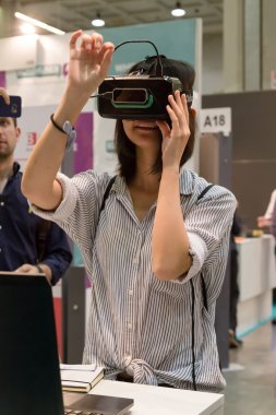 Woman trying virtual reality headset at Technology Hub in Milan,
