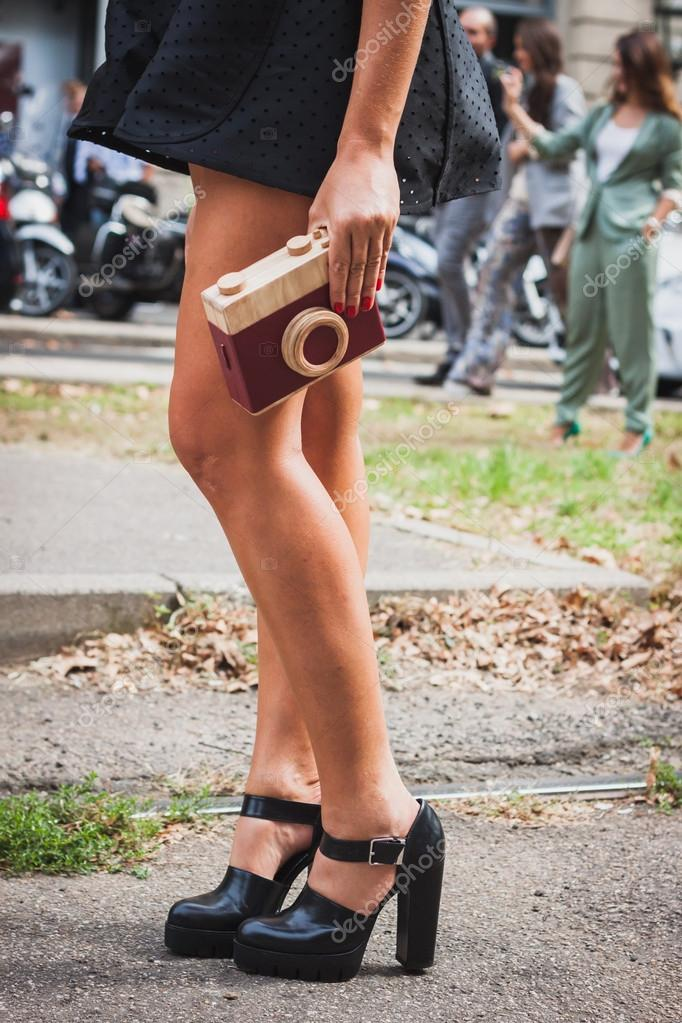 Detail of bag and shoes outside Gucci fashion shows building for Milan Women's Fashion Week 2014