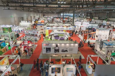 Top view of people and booths at Viscom trade fair in Milan, Italy