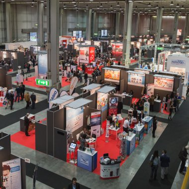 Top view of people and booths at Smau 2014 in Milan, Italy