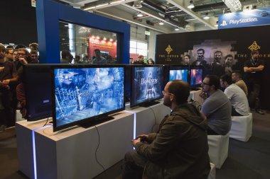 People playing at Games Week 2014 in Milan, Italy