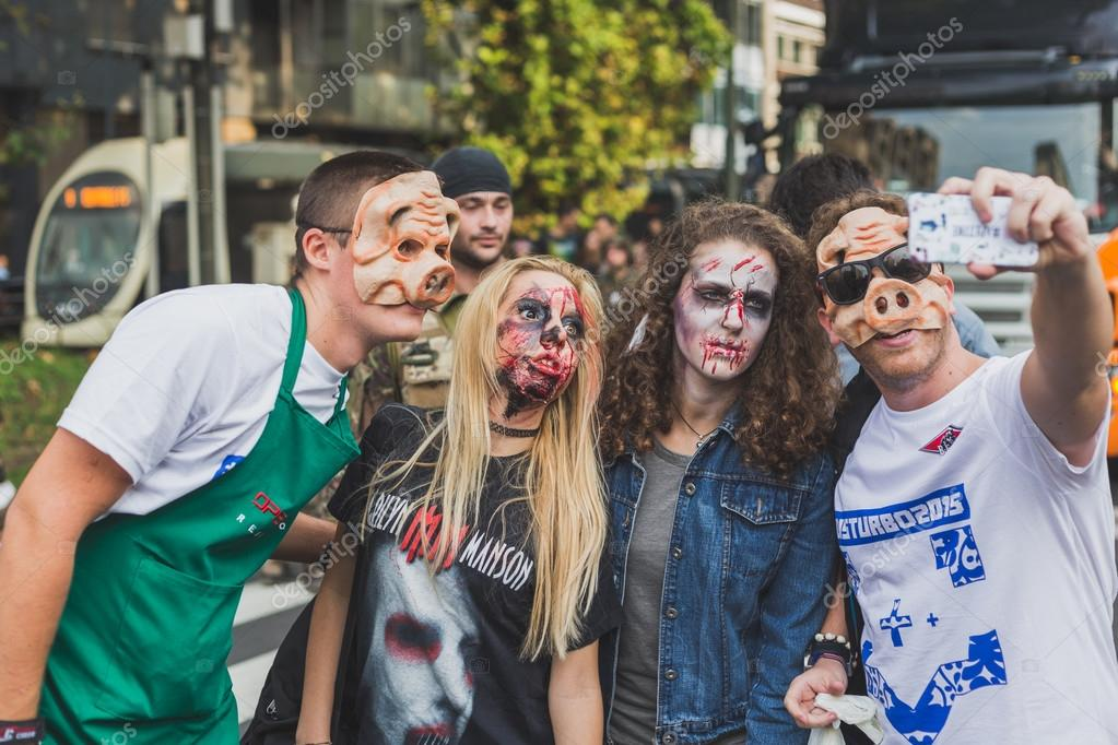 People take part in the Zombie Walk 2015 in Milan, Italy