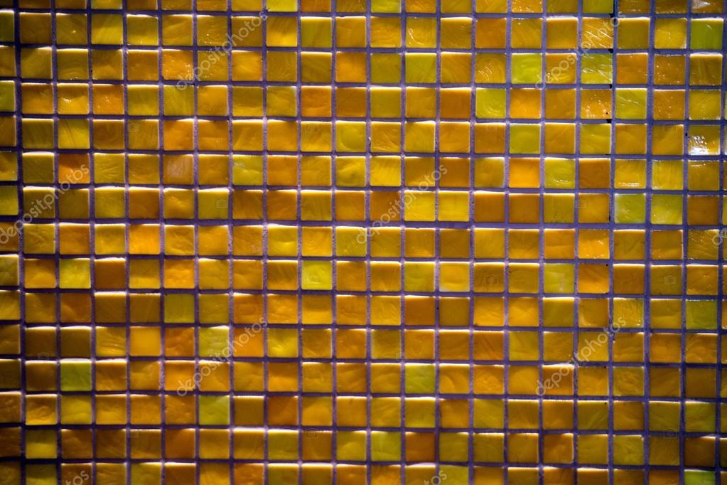 Priorità bassa delle mattonelle di mosaico arancione e giallo