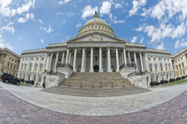 Full Washington DC Capitol on cloudy sky
