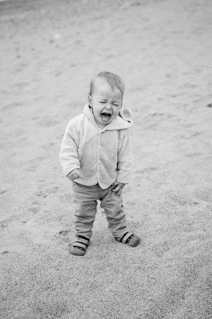 Funny toddler baby cries outdoors