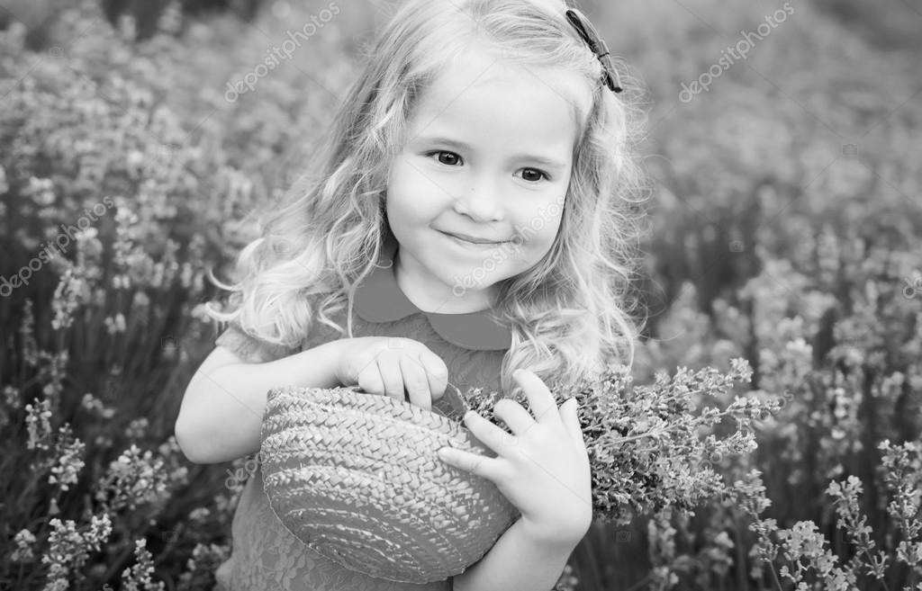 happy little girl is in a lavender field