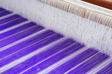 Blue Thai silk on the loom