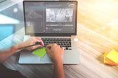 Fotografie designer hand working with digital tablet and laptop computer