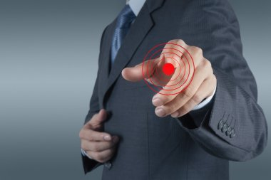 businessman hand shows target symbol as business concept