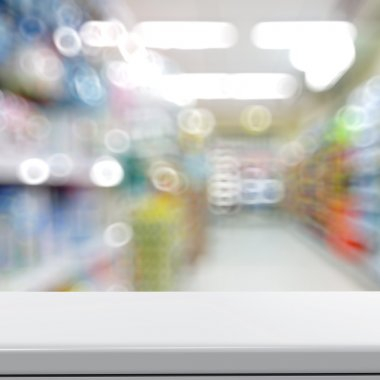 Empty laminate shelf and blurred  background for business produc